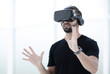 portrait of an amazed guy using a virtual reality headset isolat