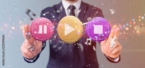 Man holding a Music button and notes playing  3d rendering - 229699666