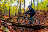 Mountain biker cycling in autumn mountains forest landscape. Man cycling MTB flow trail track. Outdoor sport activity. - 229704051