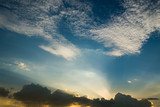Sun rays through clouds like an dramatic explosion , power nature background. - 229704837