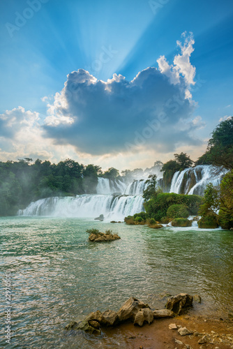 Leinwandbild Motiv Bangioc - Detian waterfall is locate at border of China and Vietnam, It's famous water fall of both country. There are boat service tourist for see nearby the waterfall.