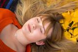 Teenage girl portrait in autumnal scenery - 229705422