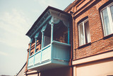Old Tbilisi architecture, windows and balcony exterior decor in summer day - 229705827