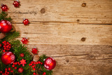 Christmas background with fir tree and decoration on dark wooden board - 229708619