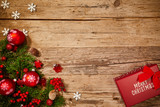 Christmas background with fir tree and decoration on dark wooden board - 229708639