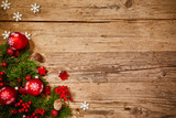Christmas background with fir tree and decoration on dark wooden board - 229708650