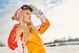 Picture of happy young lady snowboarder - 229708813