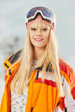 Picture of happy young lady snowboarder - 229708826