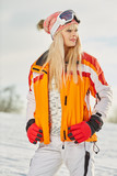 Picture of happy young lady snowboarder - 229708837