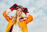 Picture of happy young lady snowboarder - 229708846