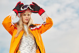 Picture of happy young lady snowboarder - 229708854