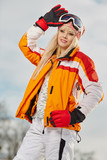 Picture of happy young lady snowboarder - 229708855