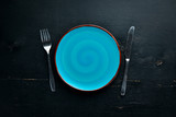 Creative Dinner Plates on Wooden background. Free space for your text. Top view. - 229723855