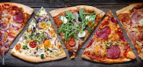 Pieces of pizza of different various types on old retro boards banner concept
