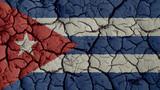 Political Crisis Or Environmental Concept: Mud Cracks With Cuba Flag