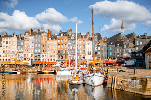 Leinwandbild Motiv Landscape view of the harbour in Honfleur, famous french town in Normandy, during the morning light