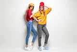 Two Girls Fooling Around. Fashion Autumn Outfit - 229737672