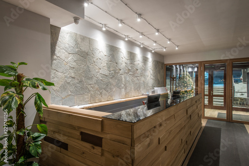 Wodeen reception desk in luxury hotel interior