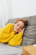 Attractive redhead woman taking a nap