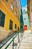 Lisbon, Portugal. Stone stairs with railings among colourful old
