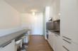 White kitchen with parquet