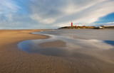 high tide on North sea coast with lighthouse - 229776031