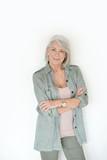 Beautiful senior woman smiling on isolated white background - 229777662
