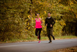 Young couple jogging together in park - 229779407
