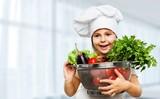Portrait of adorable little girl preparing healthy