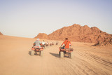 Desert in Egypt. Sharm el Sheikh. Sand and Sand Borkhan. Rock and sunset. Quad Cycle Travel. Excursion with people.