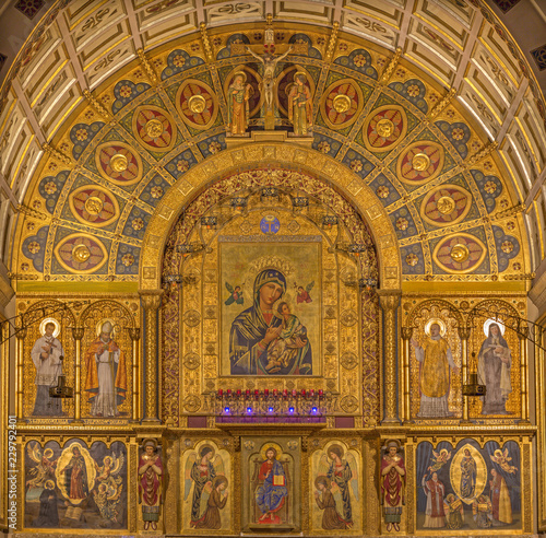 ZARAGOZA, SPAIN - MARCH 1, 2018:  The main altar  in church Iglesia del Perpetuo Socorro with the paintings by pater Jesus Faus (1953 - 1959). © Renáta Sedmáková