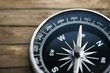 Metal antique compass on grey background