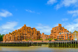 View to the shore development of the Thames at ebb tide in London, UK - 229803077