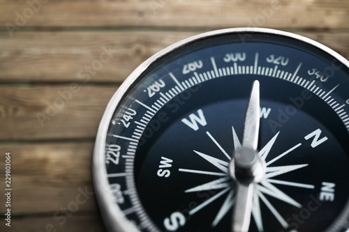 Leinwanddruck Bild Metal antique compass on grey background