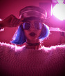 Woman in fashion winter concept wearing gold hat cap round sunglasses in pink neon light