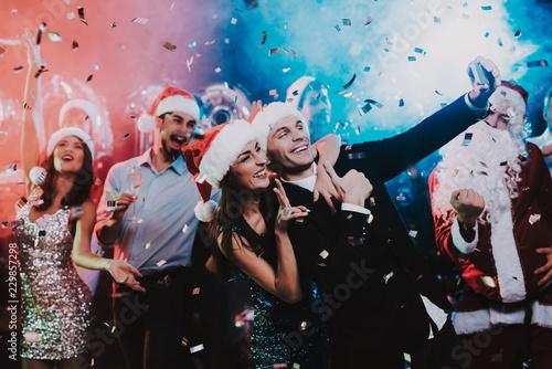 Leinwanddruck Bild Happy People Taking Selfie on New Year Party.