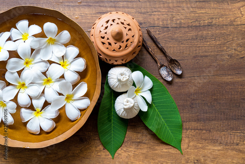Spa Thai setting for aroma therapy and sugar and salt massage with flower on the bed, relax and healthy care.  Healthy Concept - 229869016