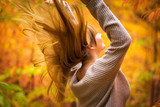Happiness of teenage girl in autumnal scenery - 229887672
