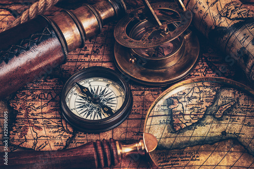Foto Murales Old vintage compass on ancient map