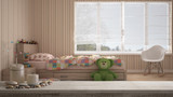 Wooden vintage table top or shelf with candles and pebbles, zen mood, over blurred modern child bedroom with single bed, minimal architecture interior design - 229896892