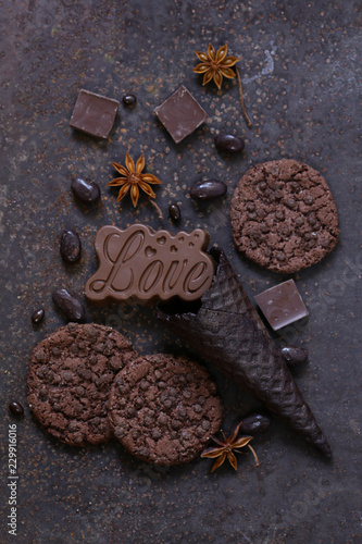 chocolate chip cookies and candy on a brown background