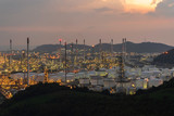 Aerial view. Petrochemical Industrial. Oil refinery and Oil industry at twilight - 229940068