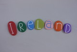 Ireland, unique souvenir with colored stones letters over white sand