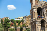 Detail of the facade of the Colosseum under a sunny day. Rome Italy. - 229948840