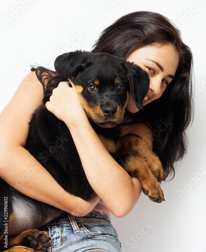 Leinwanddruck Bild girl hugging puppy