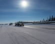 Truck Moving on the Mackenzie River Ice Road at Inuvik