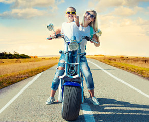 Mother and son rides on motorbike.