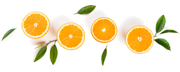 Half cut oranges and green leaves. © denira