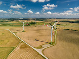 Aerial view of wind turbines generating power, located in Lithuania, on summer day. - 230008007