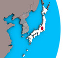 Japan with embedded national flag on simple political 3D globe. - 230018021